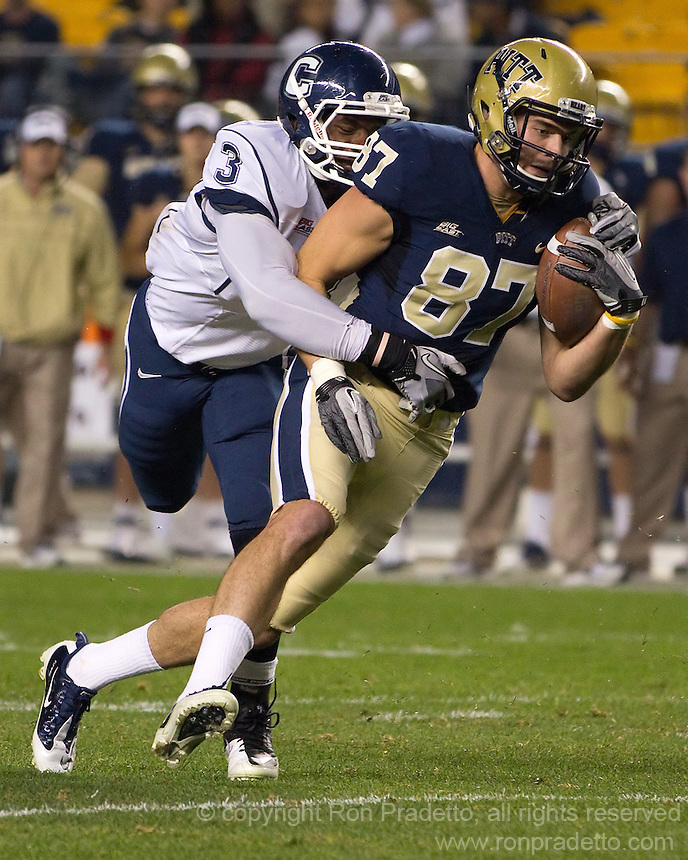 Pitt wide receiver Mike Shanahan breaks away from UConn linebacker Sio Moore (3). The Pittsburgh Panthers beat the UCONN Huskies 35-20 at Heinz field in Pittsburgh, Pennsylvania on October 26, 2011.