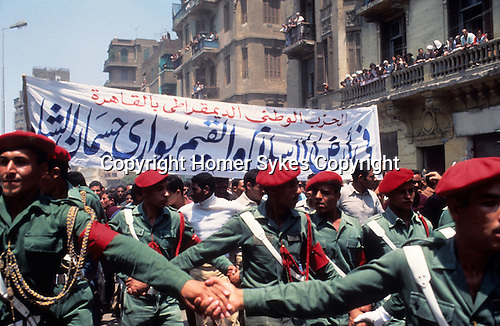 Shah of Iran his state funeral Cairo Egypt. Soldiers hold back crowds in the streets of Cairo. 1980