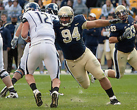 Pittsburgh Defensive lineman Myles Caragein (94) sacks the UConn quarterback Cody Endres (12).Pittsburgh Panthers defeat the University of Connecticut Huskies 24-21 on October 10, 2009 at Heinz Field, Pittsburgh, PA.