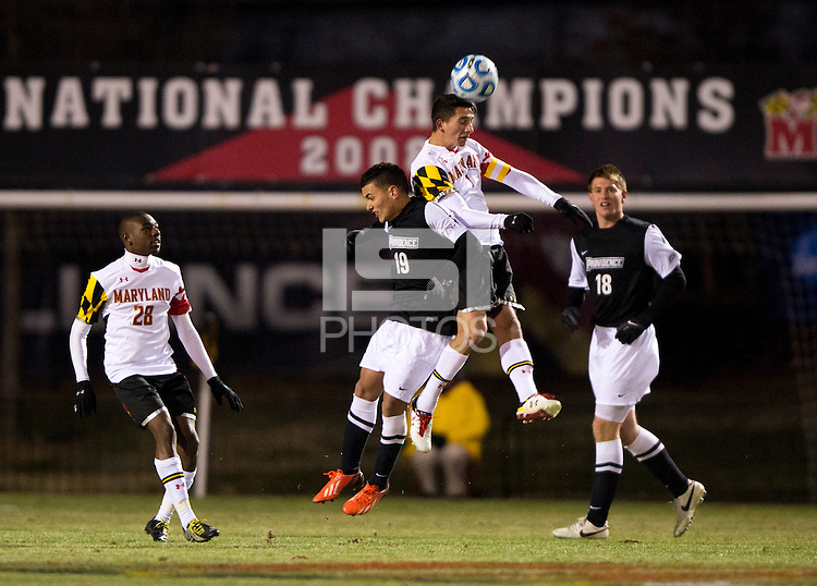 Dan Metzger (7) of Maryland goes up for a header with Dominik Machado (19) of Providence during the second round of the NCAA tournament at Ludwig Field in College Park, MD.  Maryland defeated Providence, 3-1.
