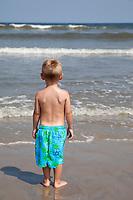 Little Boy Confronts the Atlantic Ocean.  Outer Banks, North Carolina, USA.