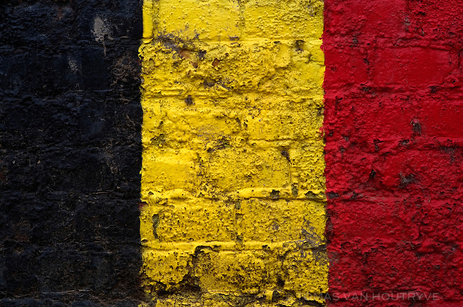 The color of the Belgian flag is painted on a brick wall in Oreye, Belgium on April 23, 2013.