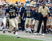 30 September 2006: Pitt tight end Darrell Strong heads downfield as Pitt head coach Dave Wannstedt (with headset) urges him on.  The Pitt Panthers defeated the Toledo Rockets 45-3 on September 30, 2006 at Heinz Field, Pittsburgh, Pennsylvania.