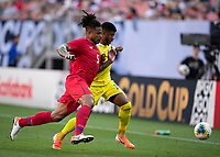 CLEVELAND, OH - JUNE 22: Roman Torres #5 and Emery Welshman #10 go for the ball during a game between Panama and Guyana at FirstEnergy Stadium on June 22, 2019 in Cleveland, Ohio.