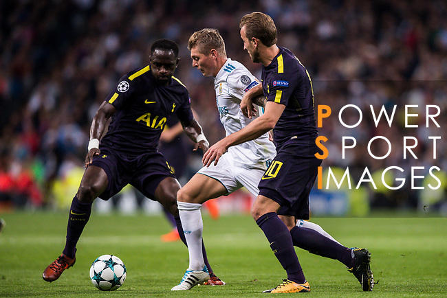 Toni Kroos of Real Madrid (C) fights for the ball with Harry Kane of Tottenham Hotspur FC (R) and Moussa Sissoko of Tottenham Hotspur FC (L) during the UEFA Champions League 2017-18 match between Real Madrid and Tottenham Hotspur FC at Estadio Santiago Bernabeu on 17 October 2017 in Madrid, Spain. Photo by Diego Gonzalez / Power Sport Images