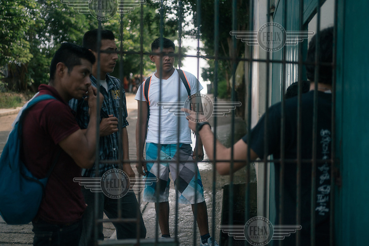 Alan (17), an unaccompanied Guatemalan migrant, waits for his turn to enter the Casa del Caminante Jtatic Samuel Ruiz Garcia shelter. That morning, he escaped from a bus where Mexican immigration agents were detaining migrants. He wants to ask for asylum in the U.S., where he hopes to stay with family members in Maryland.
