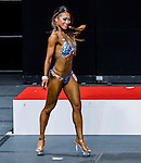 A bodybuilder competes in the Women's Fitness Physique (Round 2) category during the 2016 Hong Kong Bodybuilding Championships on 12 June 2016 at Queen Elizabeth Stadium, Hong Kong, China. Photo by Lucas Schifres / Power Sport Images