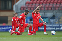 Orient players take a knee during Leyton Orient vs Port Vale, Sky Bet EFL League 2 Football at The Breyer Group Stadium on 20th February 2021