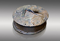 Early Minoan round metal jewel box with a dog in relief on lid,  George of the Dead 2600-2300 BC BC, Heraklion Archaeological  Museum, grey background  .
