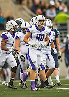 8 October 2016: Amherst College Purple & White Inside Linebacker Evan Boynton, a Senior from Concord, MA, breaks a huddle during game action against the Middlebury College Panthers at Alumni Stadium in Middlebury, Vermont. The Panthers edged out the Purple & While 27-26. Mandatory Credit: Ed Wolfstein Photo *** RAW (NEF) Image File Available ***