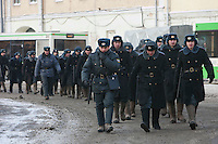 Moscow, Russia, 04/02/2012..Russian police wearing traditional valenki felt boots against the cold as tens of thousands of demonstrators march in central Moscow and protest against election fraud and Prime Minister Vladimir Putin in temperatures of -20 centigrade. Organisers claimed an attendance of 130,000 despite the bitter cold.