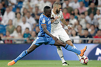 Real Madrid's Karim Benzema (r) and Getafe CF's Djene Dakoman during La Liga match. August 19,2018.  *** Local Caption *** © pixathlon<br /> Contact: +49-40-22 63 02 60 , info@pixathlon.de