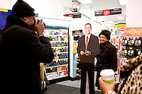 Rita Scott of San Jose, CA poses for a photo next to a cardboard cutout of Barack Obama at a drugstore in Washington, D.C. on January 19th, 2009, the day before Obama's inauguration.