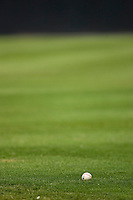 A baseball sits in the outfield grass at L.P. Frans Stadium August 9, 2009 in Hickory, North Carolina. (Photo by Brian Westerholt / Four Seam Images)