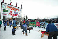 Dog Musher John Baker in the starting shoot for the 1000 mile 2003 Iditarod sled dog race from Fairbanks to Nome, Alaska . Lack of snow along the normal trail route further south forced the relocation of the restart on the Chena River in Fairbanks.