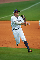 NW Arkansas third baseman Hunter Dozier (9) throws to first after fielding a ground ball during a game against the San Antonio Missions on May 31, 2015 at Arvest Ballpark in Springdale, Arkansas.  NW Arkansas defeated San Antonio 3-1.  (Mike Janes/Four Seam Images)