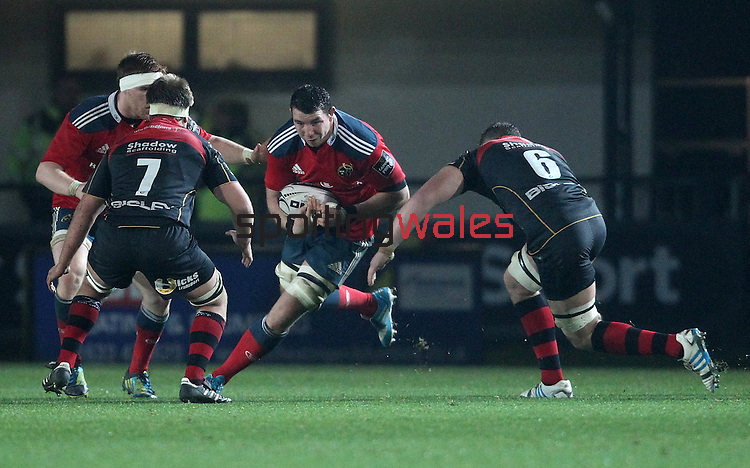 Blind-side flanker Paddy Butler of Munster Rugby is challenged by his opposite number Blind-side flanker James Thomas of Newport Gwent Dragons.<br /> <br /> Guiness Pro 12<br /> Newport Gwent Dragons v Munster Rugby<br /> Rodney Parade<br /> 21.11.14<br /> ©Steve Pope-SPORTINGWALES