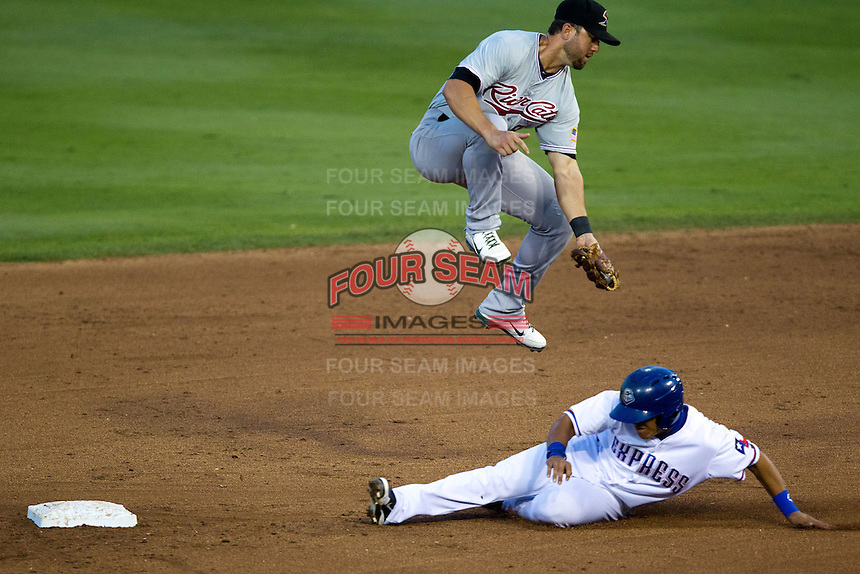 Sacramento River Cats shortstop Brandon Hicks #9 jumps over the sliding baserunner during the Pacific Coast League baseball game against the Round Rock Express on May 22, 2012 at The Dell Diamond in Round Rock, Texas. The Express defeated the River Cats 11-5. (Andrew Woolley/Four Seam Images)