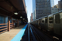 26 JUN 2014 - CHICAGO, USA - A train passes through Quincy CTA elevated train station in Chicago in the USA  (PHOTO COPYRIGHT © 2014 NIGEL FARROW, ALL RIGHTS RESERVED)