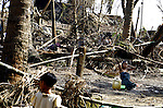 A Cyclone Nargis survivor washes up amid debris in the village of Kamingo, at the Irrawaddy Division, May 10, 2008. Despairing survivors in Myanmar awaited emergency relief on Friday, a week after 100,000 people were feared killed as the cyclone roared across the farms and villages of the low-lying Irrawaddy delta region. The storm is the most devastating one to hit Asia since 1991, when 143,000 people were killed in neighboring Bangladesh. Photo by Eyal Warshavsky  *** Local Caption *** ëì äæëåéåú ùîåøåú ìàéì åøùáñ÷é àéï ìòùåú áúîåðåú ùéîåù ììà àéùåø