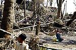A Cyclone Nargis survivor washes up amid debris in the village of Kamingo, at the Irrawaddy Division, May 10, 2008. Despairing survivors in Myanmar awaited emergency relief on Friday, a week after 100,000 people were feared killed as the cyclone roared across the farms and villages of the low-lying Irrawaddy delta region. The storm is the most devastating one to hit Asia since 1991, when 143,000 people were killed in neighboring Bangladesh. Photo by Eyal Warshavsky  *** Local Caption *** ëì äæëåéåú ùîåøåú ìàéì åøùáñ÷é àéï ìòùåú áúîåðåú ùéîåù ììà àéùåø
