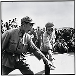 """Red Guards from the Harbin Military Engineering Institute perform the """"It is right to rebel"""" song and dance to promote Mao's """"supreme instruction""""; Harbin, Heilongjiang Province, August 22, 1966"""