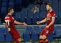 Roma s Edin Dzeko, right, celebrates with his teammate Henrikh Mikhitaryan during the Serie A soccer match between Roma and Benevento at Rome's Olympic Stadium, October 18, 2020.<br /> UPDATE IMAGES PRESS/Riccardo De Luca