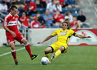 Columbus Crew defender Frankie Hejduk (2) slide tackles the ball away from Chicago Fire midfielder Chris Rolfe (17).  The Chicago Fire tied the Columbus Crew 0-0 at Toyota Park in Bridgeview, IL on July 11, 2009.