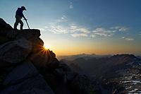 Climber on Vesper Peak at sunset, Central Cascade Mountains, Washington, USA