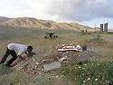 Armenia 2007 <br /> In a Yezidi graveyard  , a man kissing a grave stone                                                       <br /> Armenie 2007 <br /> Dans un cimetiere Yezidi d'un village, un homme embrassant une pierre tombale