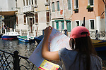 Venice Italy 2009. Lost tourist studying map of Venice.