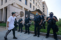 A demonstrator yells at police officers as they block Black Lives Matter Plaza near the White House in Washington D.C., U.S., on Tuesday, June 23, 2020.  Trump tweeted that he authorized the Federal government to arrest any demonstrator caught vandalizing U.S. monuments, with a punishment of up to 10 years in prison.  Credit: Stefani Reynolds / CNP/AdMedia