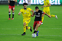 WASHINGTON, DC - OCTOBER 28: Edison Flores #10 of D.C. United battles for the ball with Youness Mokhtar #34 of Columbus Crew SC during a game between Columbus Crew and D.C. United at Audi Field on October 28, 2020 in Washington, DC.