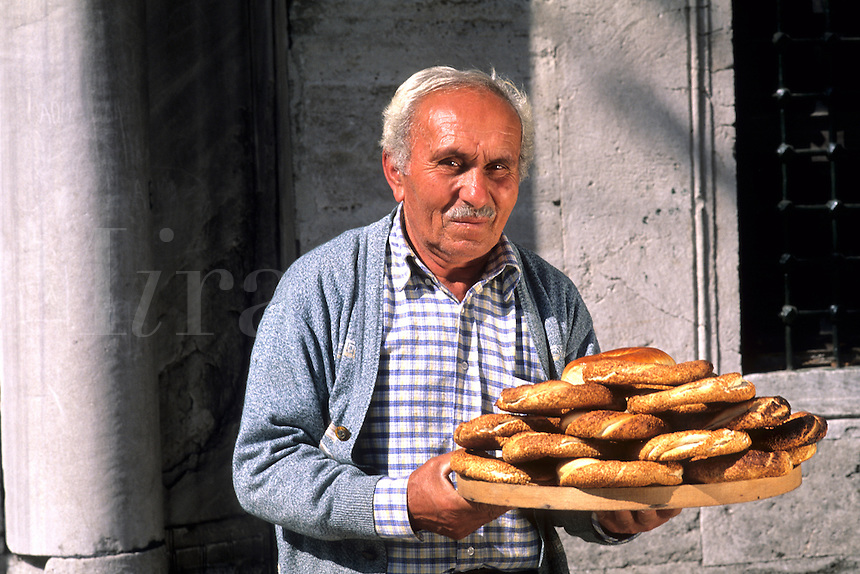 Local man selling bread with colorful scene in Istanbul Turkey