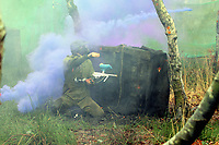 Pictured: One of the players throw back a smoke grenade.Tuesday 25 January 2011<br /> Re: Swansea City FC footballers and staff have spend a morning at Teamforce Paintball in Llangyfelach near Swansea south Wales.