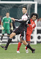Branko Boskovic #27 of D.C. United keeps the ball away from Julian de Guzman #6 of Toronto FC during an MLS match that was the final appearance of D.C. United's Jaime Moreno at RFK Stadium, in Washington D.C. on October 23, 2010. Toronto won 3-2.