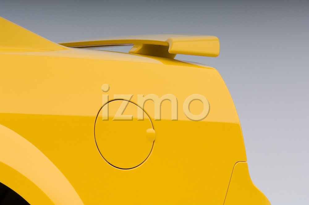 Rear quarter panel detail of a yellow 2006 Ford Mustang Coupe