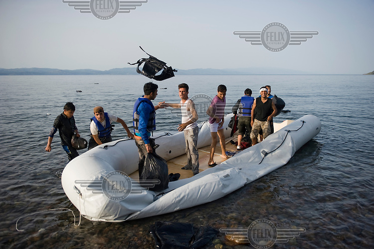 Afghan refugees discard their life jackets after they land on the beach near Skala Sykaminias on Lesbos island, Greece.Every day hundreds of refugees, mainly from Syria and Afghanistan, are crossing in small overcrowded inflatable boats the 6 mile channel from the Turkish coast to the island of Lesbos in Greece. Many spend their life savings, over $1,000, to buy a space on these boats.