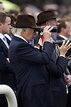 September 05, 2009: Owner of Fame and Glory, John Magnier, watches the race unfold. The Tattersalls Millions Irish Champion Stakes. Leopardstown Racecourse, Dublin, Ireland.