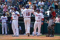 Buffalo Bisons first baseman Matt Hague (16) high fives teammates Dalton Pompey (37) and Caleb Gindl (15) after hitting a home run during a game against the Columbus Clippers on July 19, 2015 at Coca-Cola Field in Buffalo, New York.  Buffalo defeated Columbus 4-3 in twelve innings.  (Mike Janes/Four Seam Images)