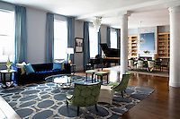 Art deco living room<br /> <br /> This is a loft duplex apartment in Manhattan which is home a young couple with 3 small children. <br /> The colorful and open family friendly space is decorated win a mix of Art Deco and 1950's styles and has a glamorous but funky interior.