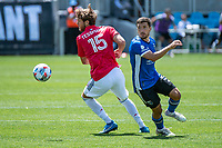 SAN JOSE, CA - APRIL 24: Tanner Tessmann #15 of FC Dallas dribbles past Eric Remedi #5 of the San Jose Earthquakes during a game between FC Dallas and San Jose Earthquakes at PayPal Park on April 24, 2021 in San Jose, California.