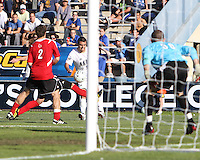 Michael Nanchoff #9 of the University of Akron crosses the ball past Brock Granger #17 and Charlie Campbell #2 of the University of Louisville during the 2010 College Cup final at Harder Stadium, on December 12 2010, in Santa Barbara, California. Akron champions, 1-0.