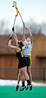 5 April 2008: University of Vermont Catamounts' Midfielder Kristen Millar, a Junior from Whitby, Ontario, jumps high to reach for possession against the University at Albany Great Danes at Moulton Winder Field, in Burlington, Vermont. With only seconds left in regulation time, the Catamounts rallied to defeat the visiting Danes 11-10 in America East conference play...Mandatory Photo Credit: Ed Wolfstein Photo