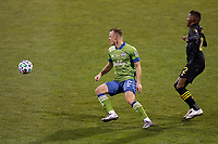 COLUMBUS, OH - DECEMBER 12: Brad Smith #2 of Seattle Sounders FC kicks the ball ahead of Derrick Etienne Jr. #22 of Columbus Crew during a game between Seattle Sounders FC and Columbus Crew at MAPFRE Stadium on December 12, 2020 in Columbus, Ohio.