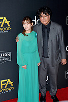 LOS ANGELES, USA. November 04, 2019: So-dam Park & Bong Joon Ho at the 23rd Annual Hollywood Film Awards at the Beverly Hilton Hotel.<br /> Picture: Paul Smith/Featureflash