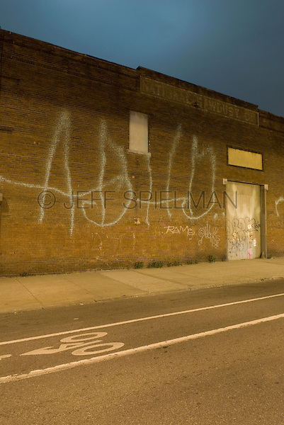 Street Scene in the Williamsburg neighborhood of Brooklyn, with Graffiti on the side of an Industrial Building, New York City, New York State, USA