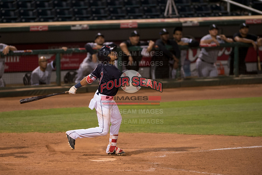 AZL Indians 1 shortstop Marcos Gonzalez (1) follows through on his swing during an Arizona League game against the AZL White Sox at Goodyear Ballpark on June 20, 2018 in Goodyear, Arizona. AZL Indians 1 defeated AZL White Sox 8-7. (Zachary Lucy/Four Seam Images)