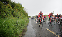 Kenny Dehaes (BEL/Lotto-Belisol) & Dennis Vanendert (BEL/Lotto-Belisol) practically have to ride with their eyes closed in these superwet conditions<br /> <br /> Giro d'Italia 2014<br /> stage 3: Armagh - Dublin 187km
