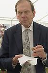 The Earl of Sandwich. John the 11th Earl of Sandwich, tasting a sandwich competition on the occasion of the 250 anniversary of the sandwich. Sandwich Kent. UK